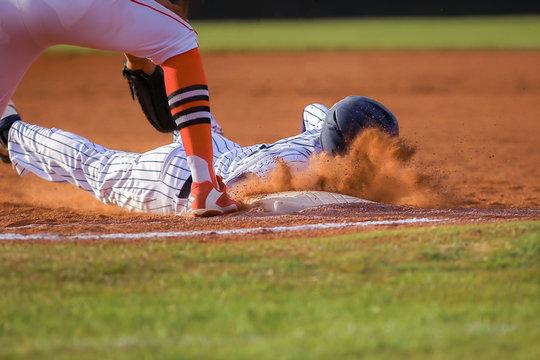 Baseball player sliding first base