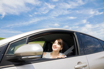 young woman showing her face from car window.