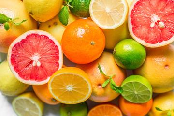 A large assortment of colorful citrus fruit (lemon, lime, orange, grapefruit, mandarin, tangerine, pomelo)
