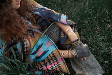 close up of beautiful boho woman hipster wearing poncho with gloves
