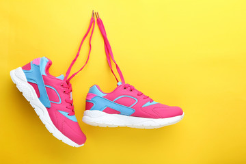 Sport shoes on yellow background