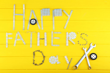 Wrench tools for fathers day on yellow wooden table
