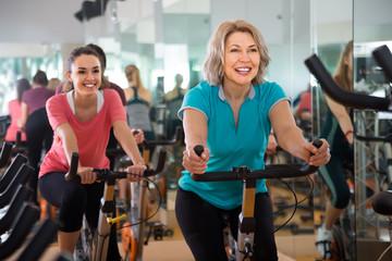 vigorous females of different age training on exercise bikes