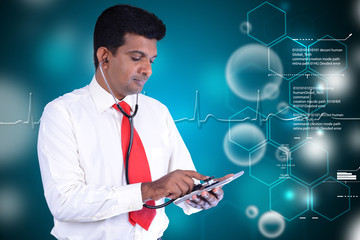 Young doctor looks digital tablet
