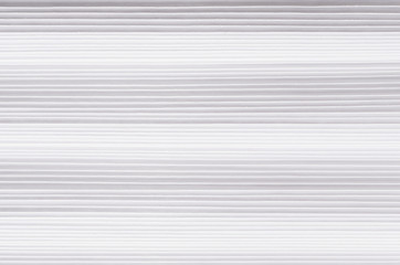 Striped wavy white paper texture, abstract background.