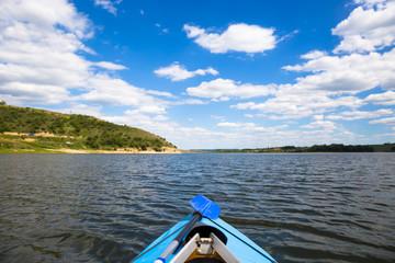 People enjou kayaking on beautiful river. Summer sunny time
