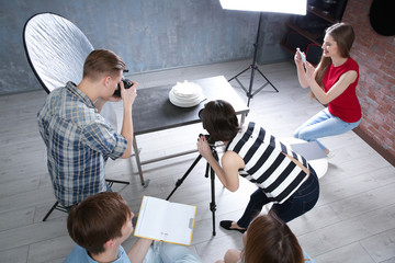 Group of students shooting objects at photography classes