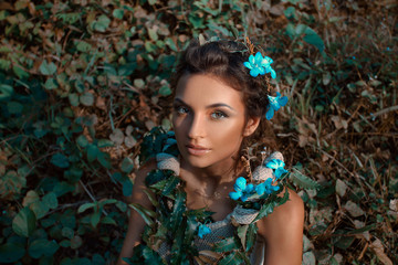 young beautiful woman portrait with flowers outdoors