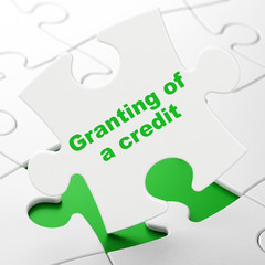 Money concept: Granting of A credit on puzzle background