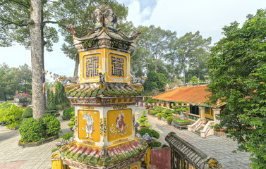 Binh Duong, Vietnam - February 5th, 2017: Architecture temple tower with large yard and house many beautiful patterned tiles due honor appreciation of Buddhism in Binh Duong, Vietnam