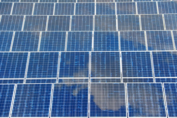 solar panel with reflection blue sky
