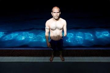 Zubair Haidari 38, poses for a picture after his practice in a swimming pool in Kabul