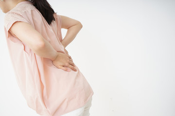 Young woman suffering from a backache