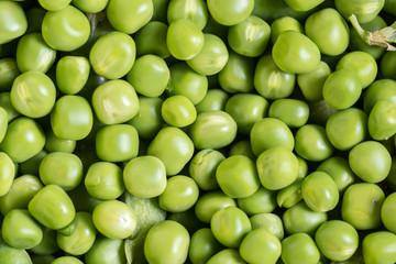 Flat lay pile of fresh green peas closeup macro