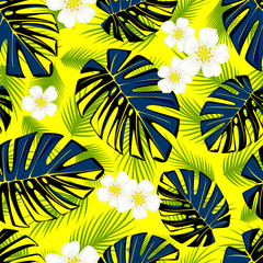 Seamless tropical pattern with monstera green leaves and white flowers.