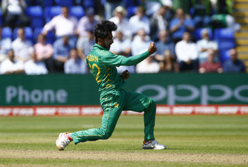 Pakistan's Hasan Ali celebrates after England's Jonny Bairstow (not pictured) is caught by Mohammad Hafeez (not pictured)