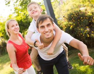 Parents with boy having fun