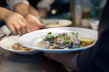 Calamari and pasta dish in restaurant
