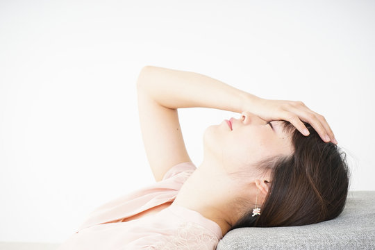Young woman getting lying down because of poor health