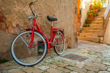 Red Bicycle on the Narrow Street of the Old City