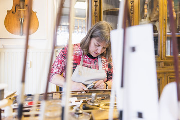 Female luthier working in her workshop