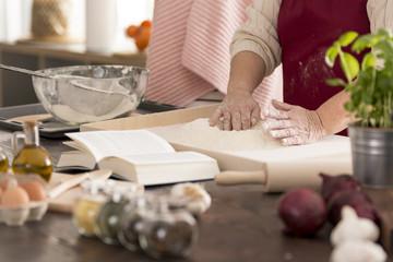Woman preparing dough for pasta