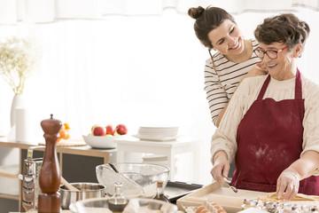 Granddaughter cooking with grandma
