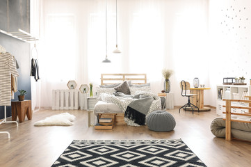 Multifunctional apartment with pallet bed