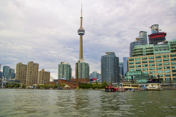 Toronto, Ontario, Canada harbor waterfront on a cloudy day with the CN tower and the financial district in the background