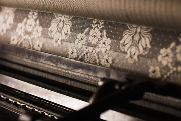 Lace roll on old weaving machine in textile mill