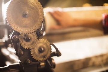 Cogs on old weaving machine in textile mill