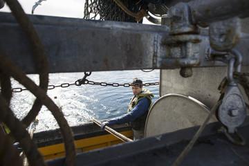 Fisherman preparing net reel