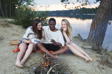 Friends camping by lake