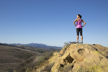 Mature female runner looking out from hill, Thousand Oaks, California, USA