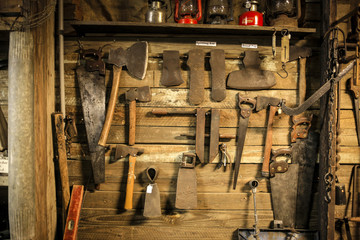 Old tools hanging on a wall in an old garage in Florida