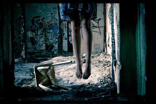 A woman hanging suicide. Dark noise concept.