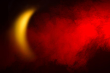 Red smoke and crescent-shaped light. Concept, an Islamic symbol.