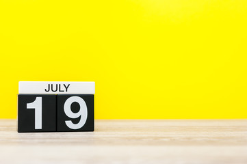 July 19th. Image of july 19, calendar on yellow background. Summer time. With empty space for text