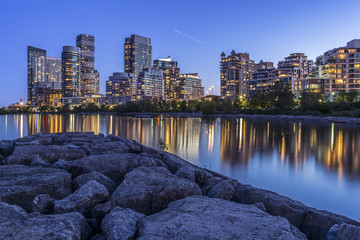 Toronto's west end cityscape (condo buildings lit up at nighttime near the lake shore).