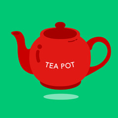 RED TEA POT Red ceramic teapot on the light green background.