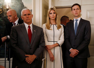 White House aides listen as U.S. President Trump delivers statement after shooting at a Congressional Republicans baseball practice at the White House in Washington