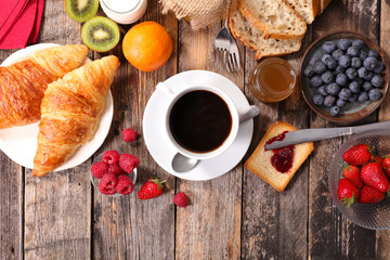 breakfast with coffee,croissant and fruits