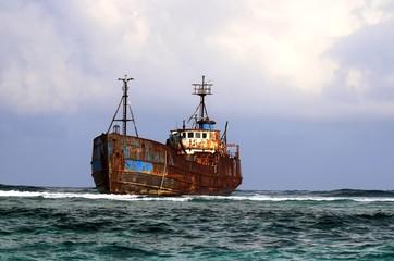 Boat stranded on reef