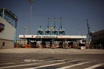 The entrance for trucks to a cargo terminal is seen closed next to idle cranes during the first day of a 48-hour nation-wide strike of dockers in the port of Algeciras