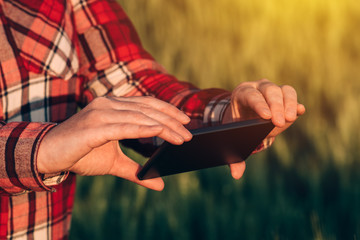 Agronomist using smart phone camera mobile app