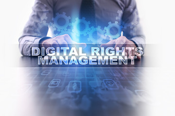 Businessman working with modern tablet pc and selecting digital rights management.