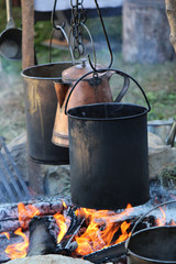 1800's cooking pots over a fire