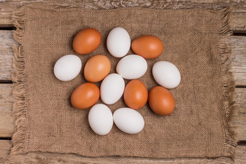 Top view of eggs on sackcloth