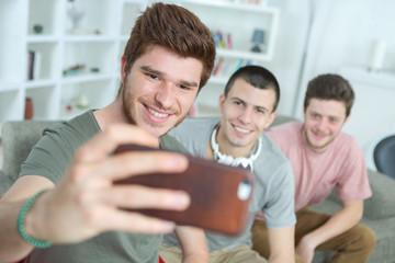 the friends taking selfie