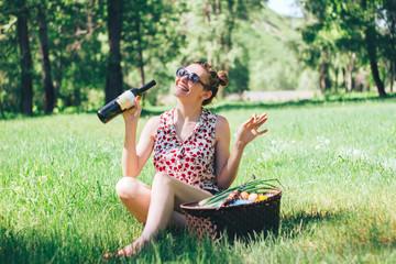 happy girl drink wine on backyard